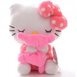 Mignonne peluche Hello Kitty tenant un coussin